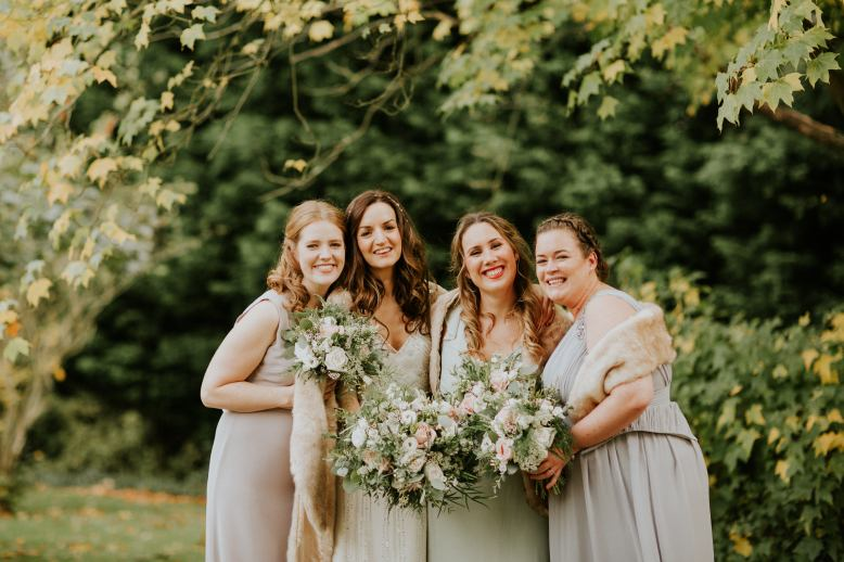 Bridal party holding their wedding bouquets