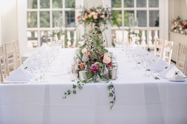 Intimate dinner set up with floral table runner