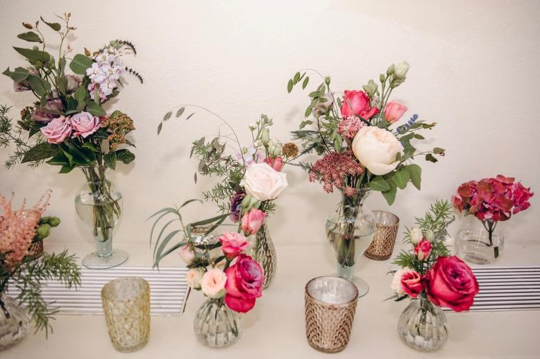 Mismatched vases decorating radiator cabinets.
